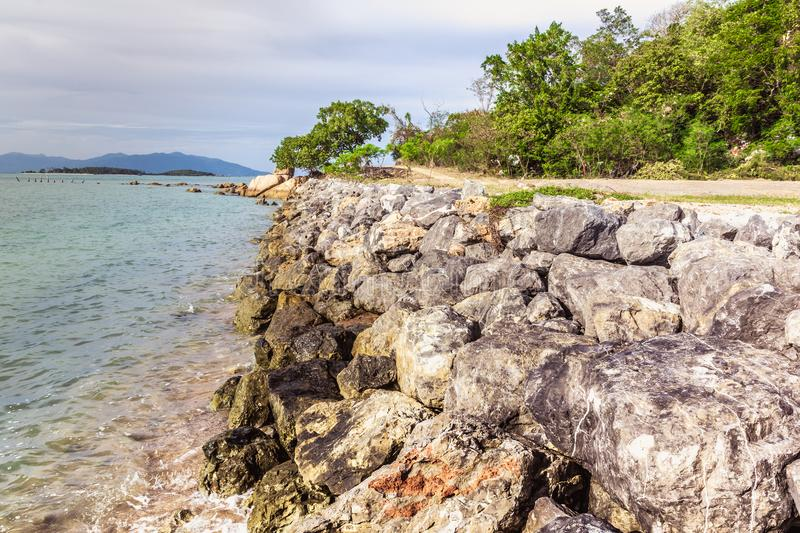 The seaside road, the stone wall, the banks of the river. Sea vi. Ew and beautiful sky royalty free stock image