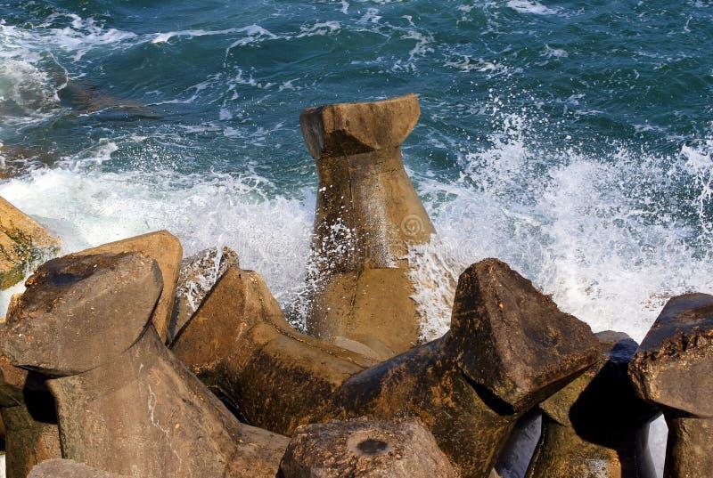 Seaside stone pier royalty free stock photography
