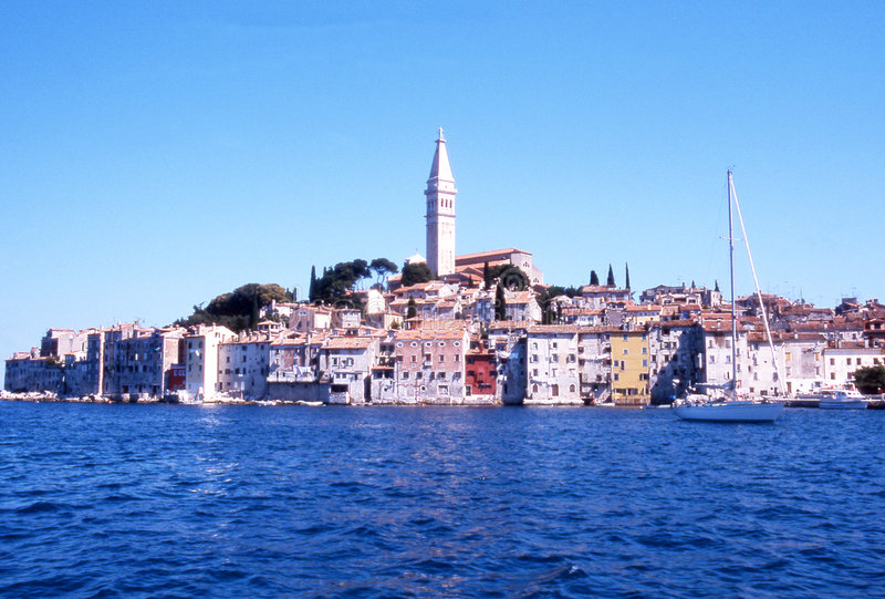 Seaside town. With colorful homes in a sunny day on the sea, clear blue sky background -rovinj - Croatia stock photo