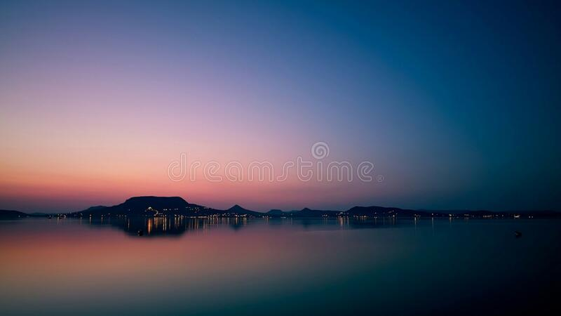 Seaside town and landscape at dusk royalty free stock image