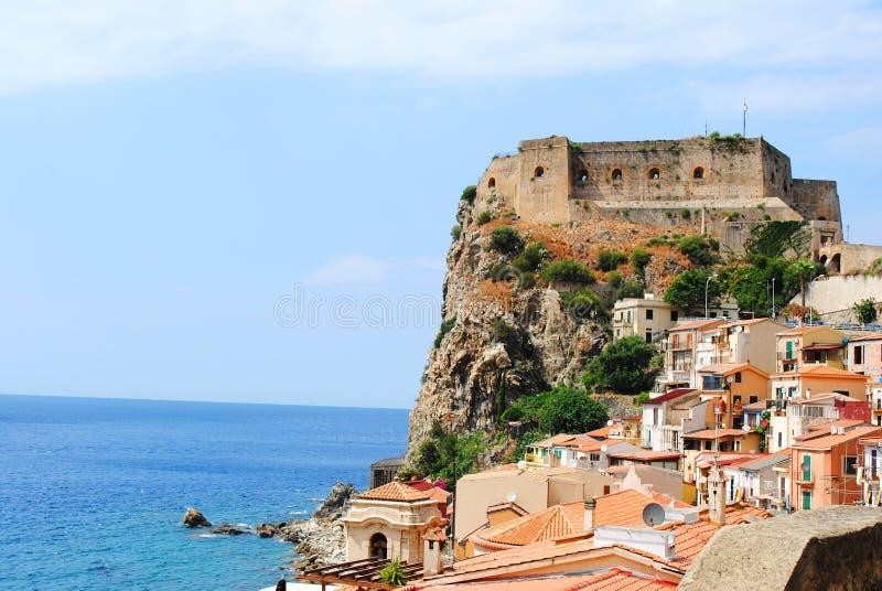 Seaside town Scilla with castle on rock Castello Ruffo. Mediterranean Tyrrhenian sea coast. Scilla, Calabria, Italy. July 2019 royalty free stock photography