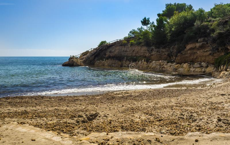 Seaside view in l`Ametlla de Mar. Looking down into one of the beatiful small beaches in the town stock photography