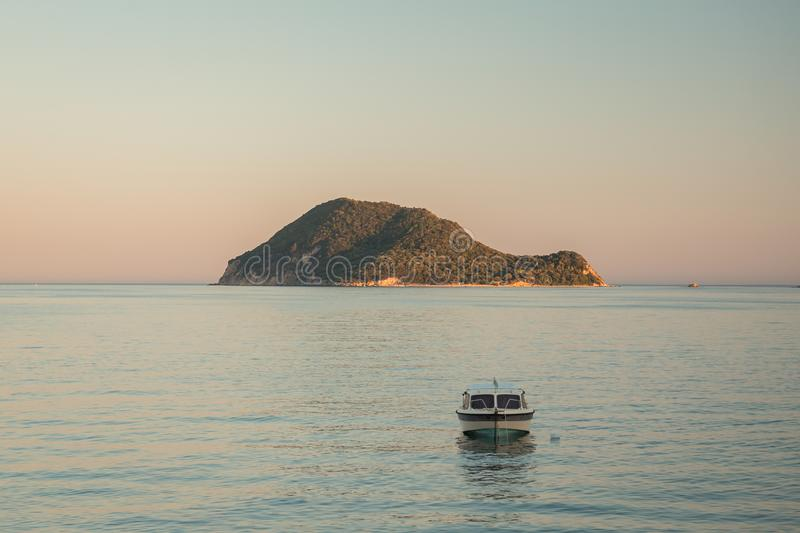 Seaside view of the Marathonisi or Turtle island near Greek island Zakynthos in the Ionian Sea wuht a boat in front of stock photos