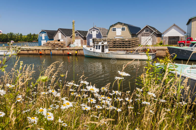 Seaside view of Prince Edward Island Canada. Boats docked at fishing village near Cavendish, Prince Edward Island, Canada stock image