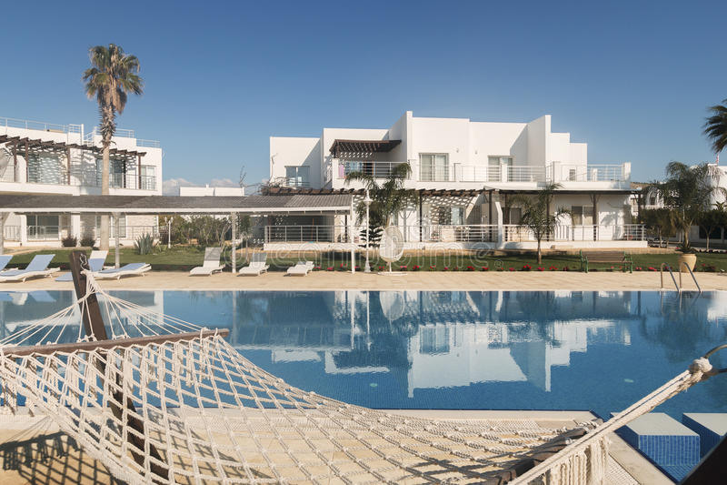 Seaside villa, hammock at the pool stock images