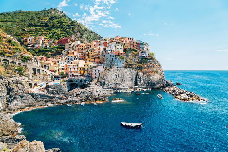 Seaside village Manarola, Colorful buildings and beach in Cinque Terre, Italy. Seaside village Manarola Colorful buildings and beach in Cinque Terre, Italy royalty free stock images