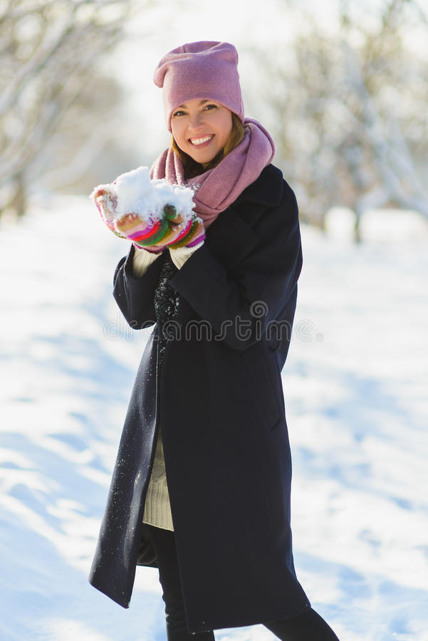 Season, christmas, holidays and people concept - smiling young woman in winter clothes outdoor.  royalty free stock photos