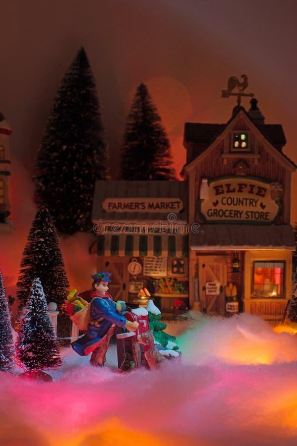 Season greeting with Christmas miniature scenery stock image