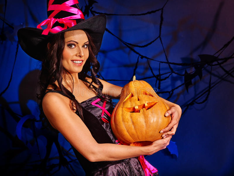 Season of Pumpkin is here. Witch learns make Jack OLanten. stock images