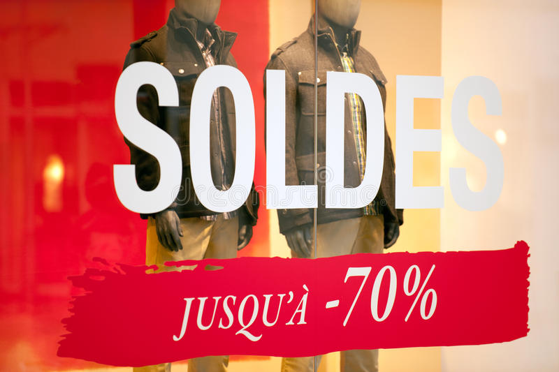 Season sale. S sign on the window of French clothing store stock images