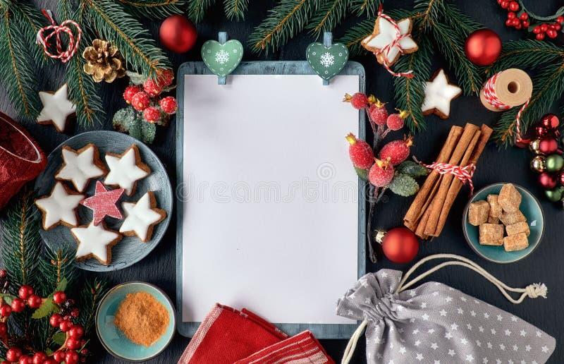 Seasonal background with decorated Christmas tree twigs on dark royalty free stock photos