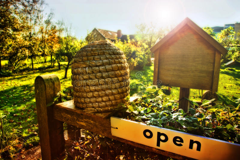Seasonal bee farm. Bee house in country place royalty free stock image