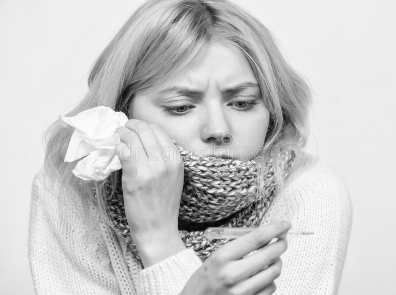 Seasonal flu concept. Woman feels badly. How to bring fever down. Fever symptoms and causes. Sick girl with fever. Girl. Sick hold thermometer and tissue royalty free stock photos