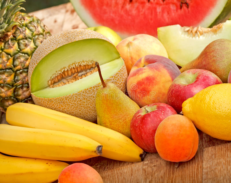 Seasonal fruits in summer. On table royalty free stock photo