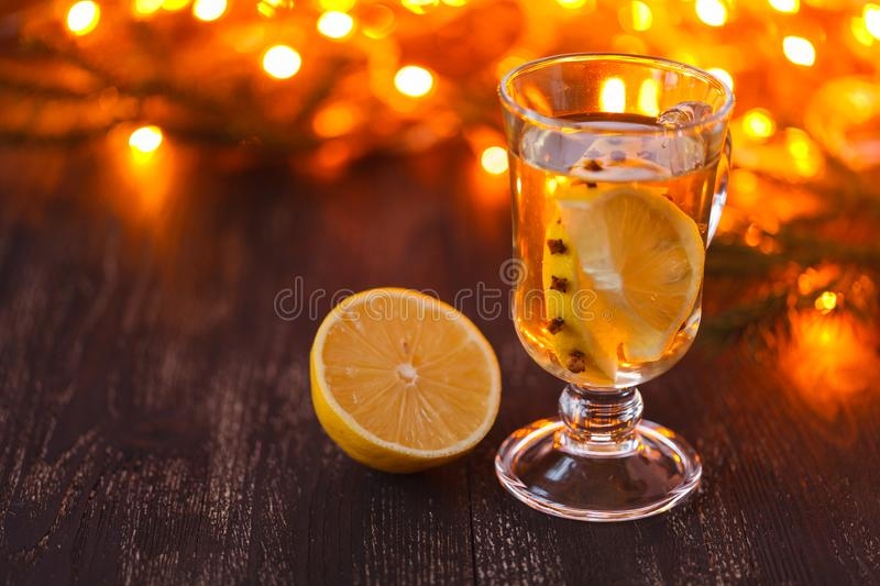 Seasonal and holidays concept. Christmas and autumn theme. One glasses mulled wine on a rustic wooden table. Selective focus royalty free stock photography