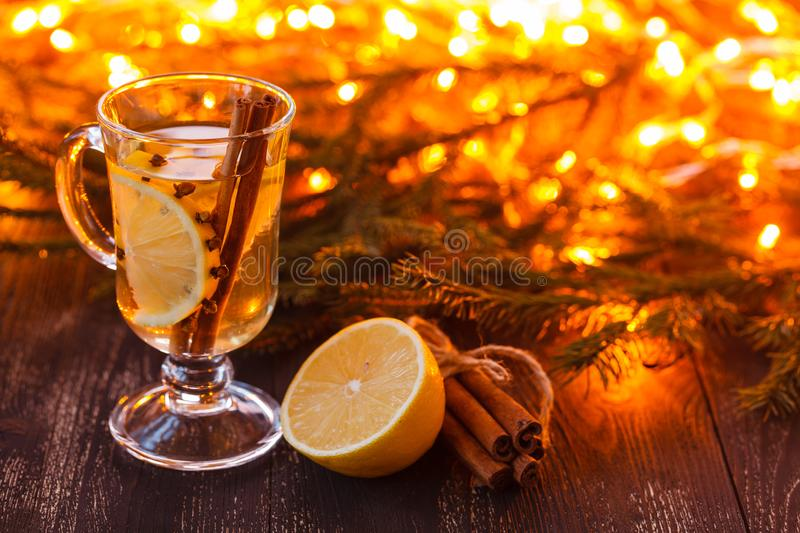 Seasonal and holidays concept. Christmas and autumn theme. One glasses mulled wine on a rustic wooden table. Selective focus royalty free stock photos