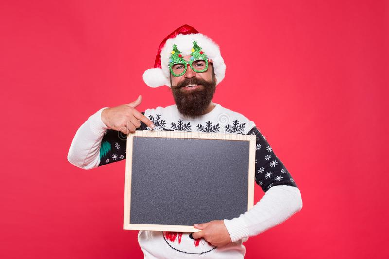 Seasonal offer. Christmas offer. Happy hours. Special offer concept. Winter announcement. Bearded emotional hipster man stock image