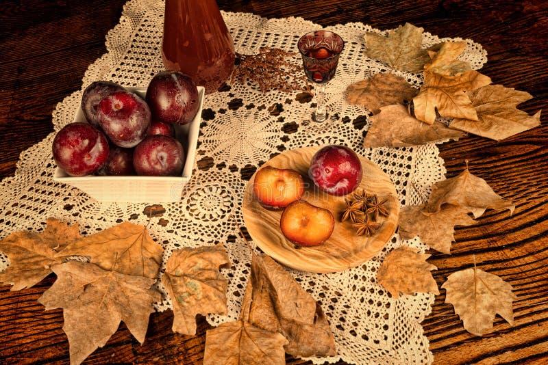 Seasonal plum brandy stock photo