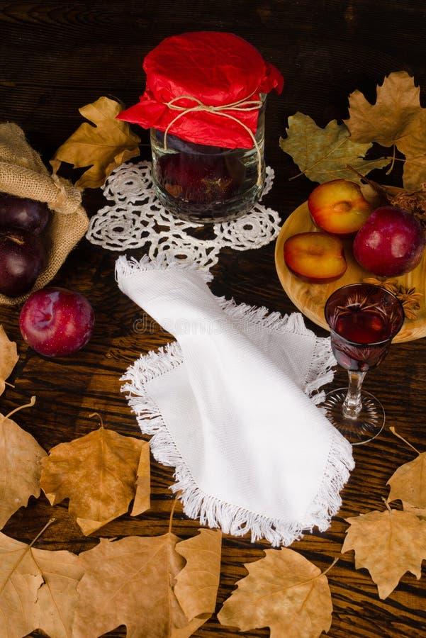 Seasonal plum brandy and ingredients stock images