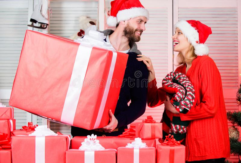 Seasonal sale. Guy with big gift box. Spread happiness. Big surprise for her. Preparing presents for christmas. New year stock image