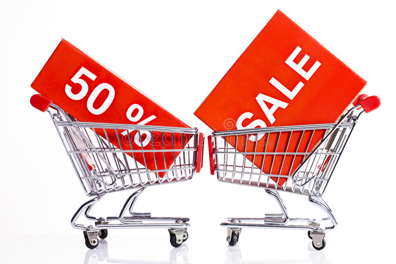 Seasonal sales. Shopping carts isolated on white with sale icons royalty free stock images