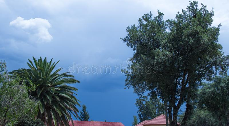 Seasonal stormy summer weather Gauteng South Africa. Threatening summer storm clouds gather above a residential area on the Gauteng Highveld in South Africa stock photos