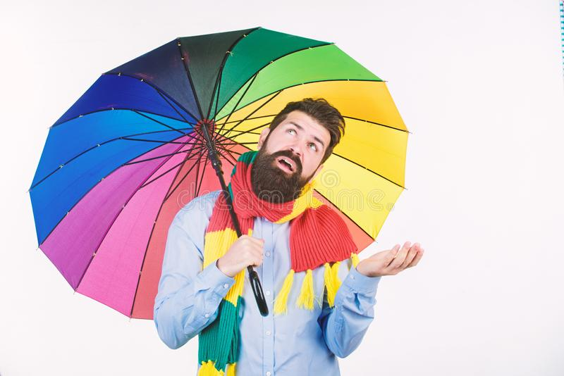 Seasonal weather forecast. Man bearded hipster hold colorful umbrella. It seems to be raining. Rainy days can be tough. To get through. Prepared for rainy day royalty free stock photos