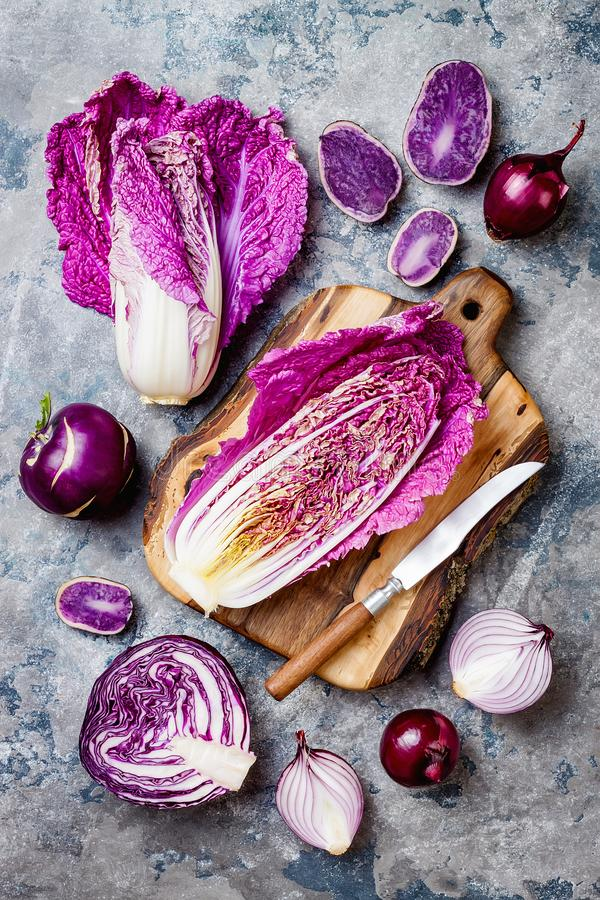 Seasonal winter autumn purple vegetables over gray stone table. Plant based vegan or vegetarian cooking concept. Clean eating food. Seasonal winter autumn purple stock photo