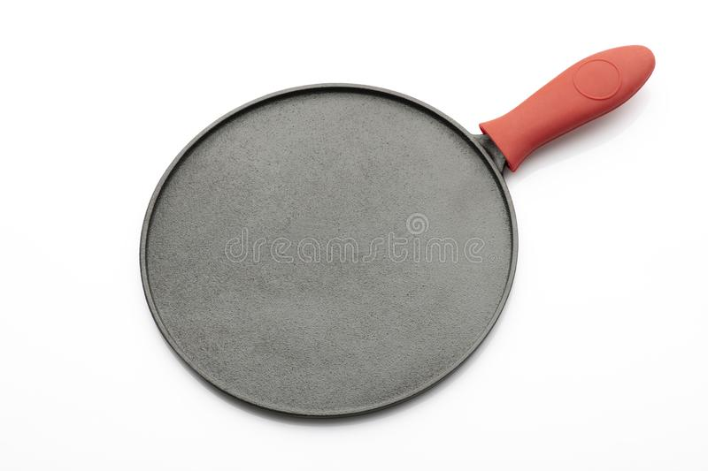 Seasoned Cast Iron Pan on White Background with Red Silicon Handle Grip royalty free stock photography