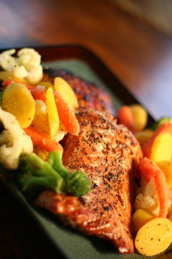 Seasoned Salmon on Vegetables stock photography