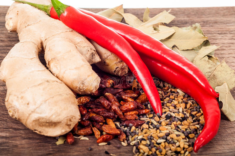 Seasoning concept - Assortment of fresh and dry spices on wooden royalty free stock photos