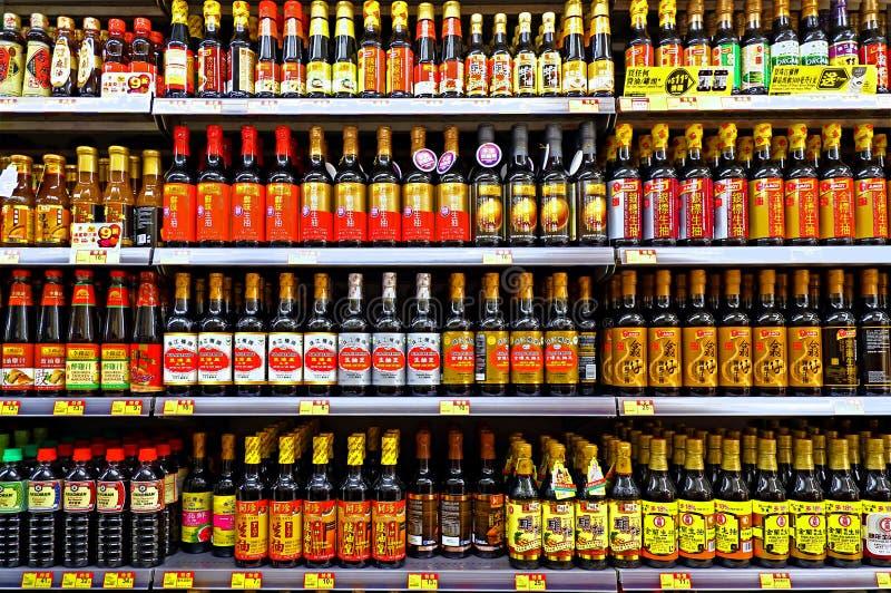 Seasoning soy sauce bottles at supermarket royalty free stock images