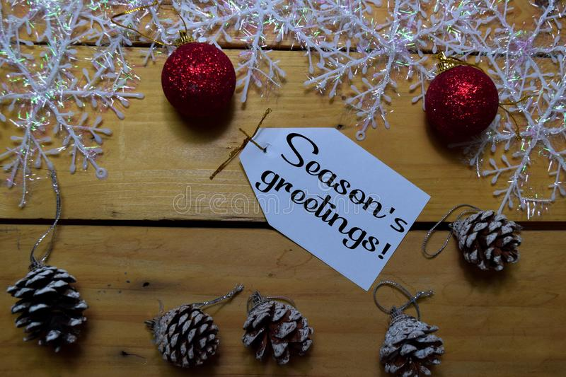 Seasons Greetings write on laber with wooden backgroud. Frame of Christmas Decoration royalty free stock images
