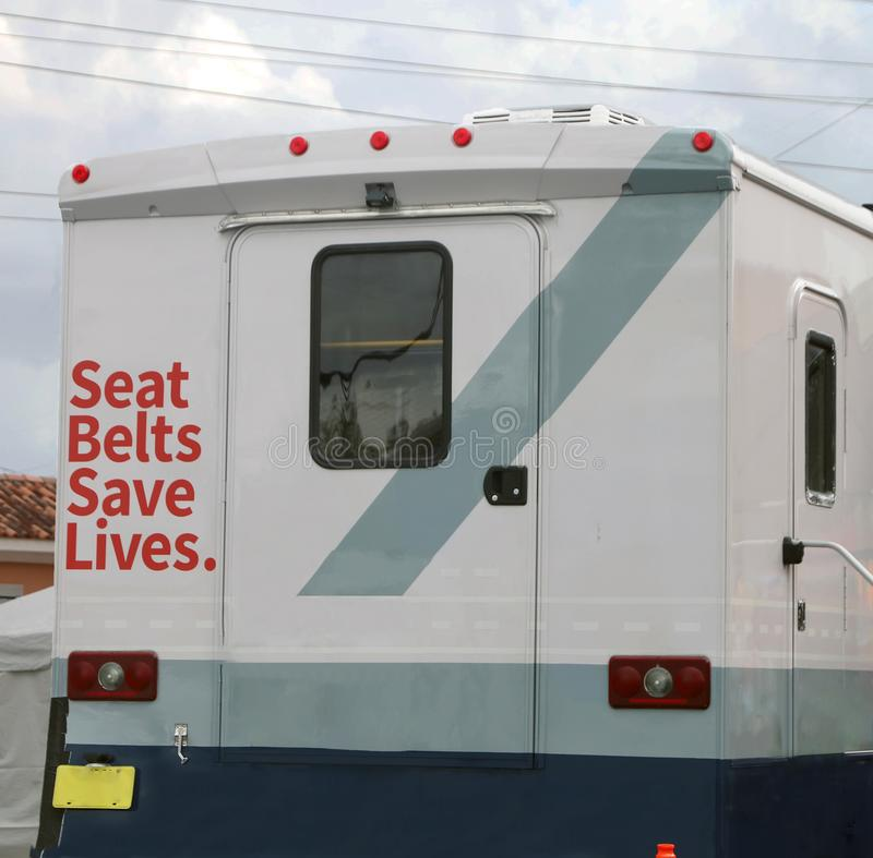 Seat Belts Save Lives. Written on the rear side of a vehicle. Many lives are saved each year in the United States because drivers and their passengers were royalty free stock photos