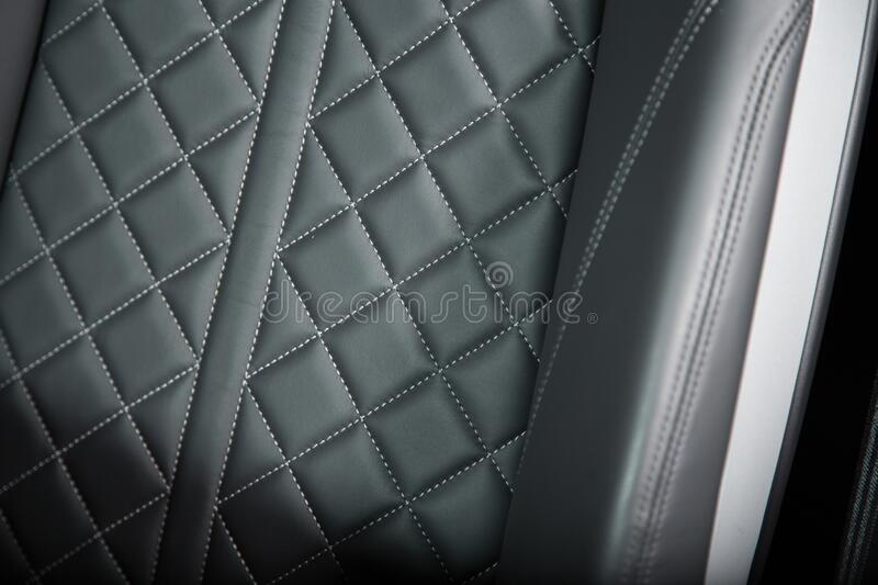Seat detail picture of a sports car. Featuring diamond stitching stock photo