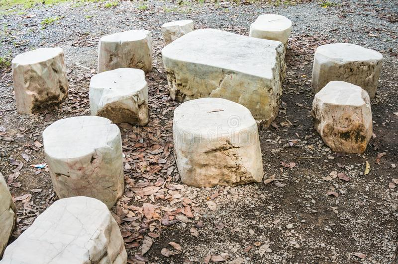 Seat group natural stone consists of table and stools. Seat group natural stone consists of table and stools royalty free stock photo