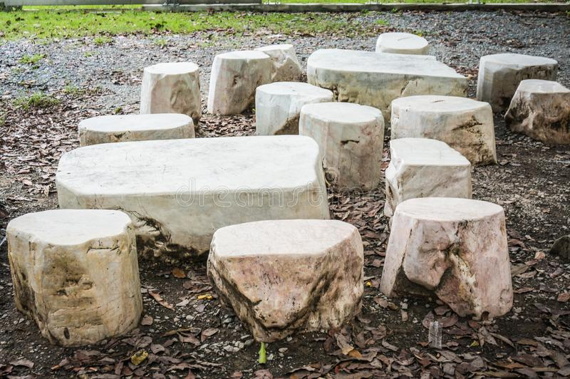 Seat group natural stone consists of table and stools. Seat group natural stone consists of table and stools royalty free stock photography
