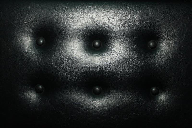 Seat-leer zacht met knopen van zwart leer stock afbeelding