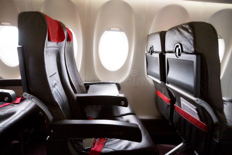 Seat-rijen in een vliegtuigcabine royalty-vrije stock afbeeldingen