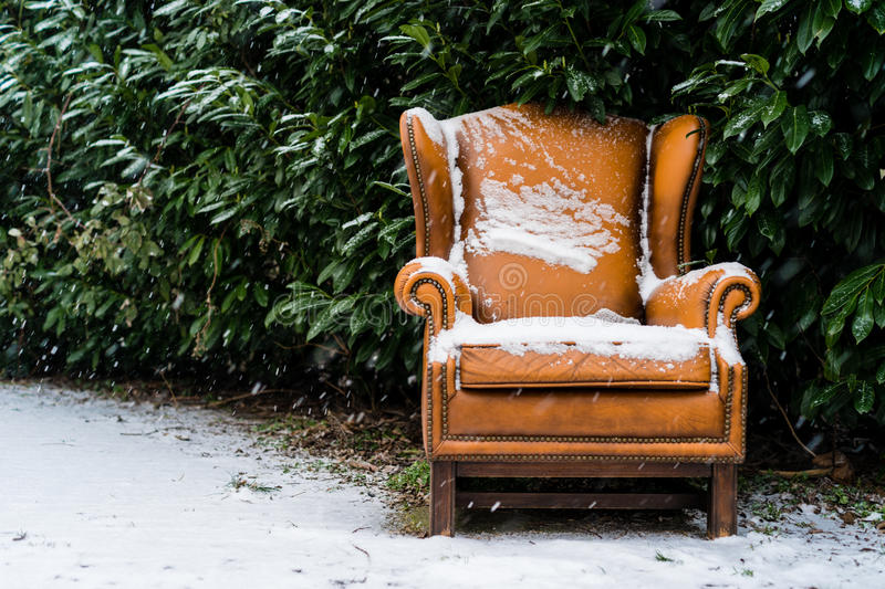 Seat in snow. Seat along the road during snowfall stock images
