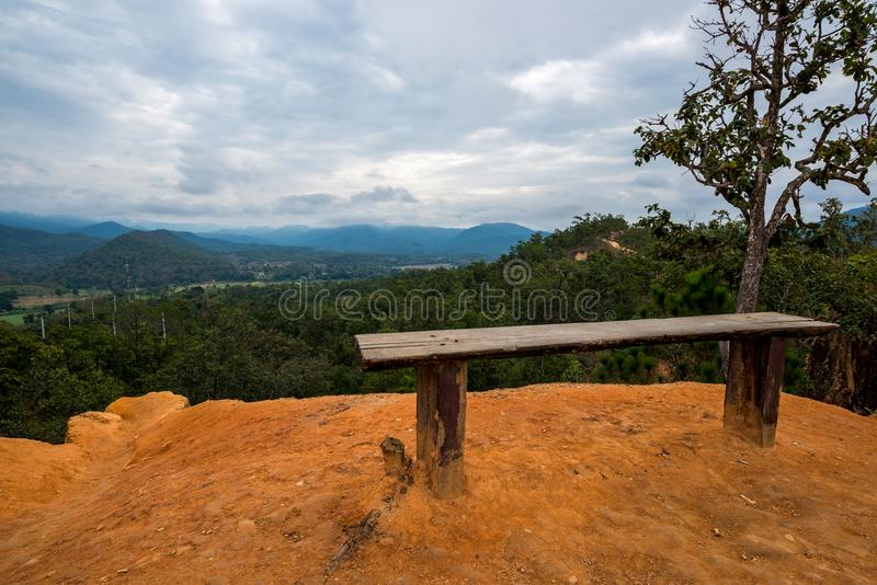 Seat at the Soil Cliff Phenomenon by nature in the hill of forest mountain with cloudy sky. Countryside at the north of Thailand Mae Hong Son royalty free stock photos