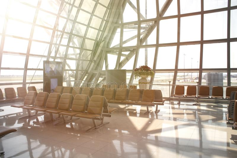 Seat Waiting Area International airport building View of the Planes and runway outside the window.  stock photography