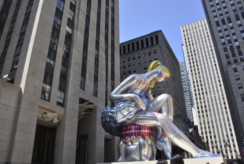 Seated Ballerina in Rockefeller Plaza from Manhattan in New York City in United States. Seated Ballerina infatable doll a message to alert to International stock images