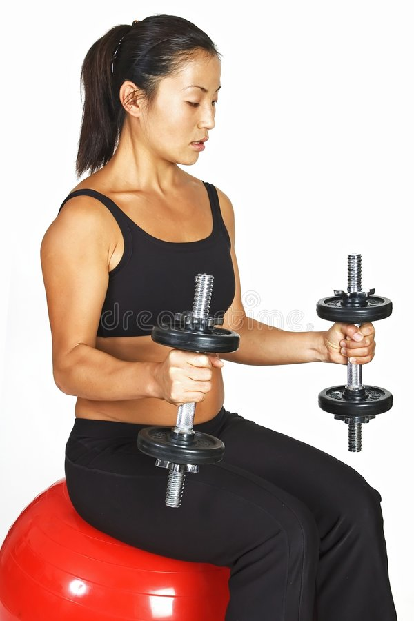 Seated dumbbell curl stock images