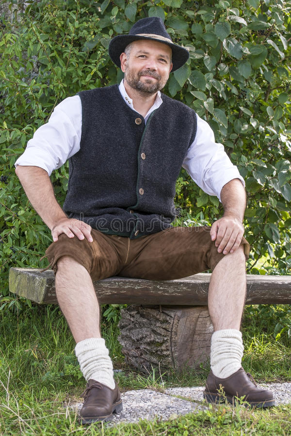 Seated Man In Traditional Bavarian Costumes Stock Photo