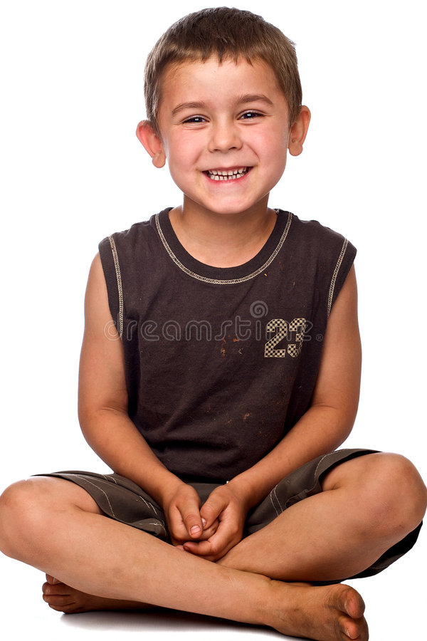 Download Seated Young Boy With Dirty Feet Laughing Stock Image - Image: 7082261