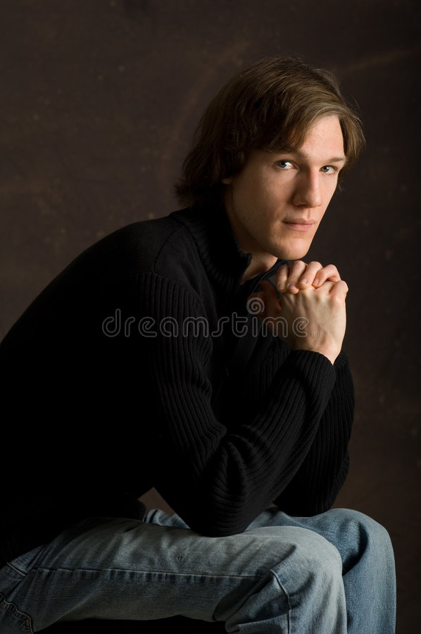 Seated Young Male Portrait Royalty Free Stock Image