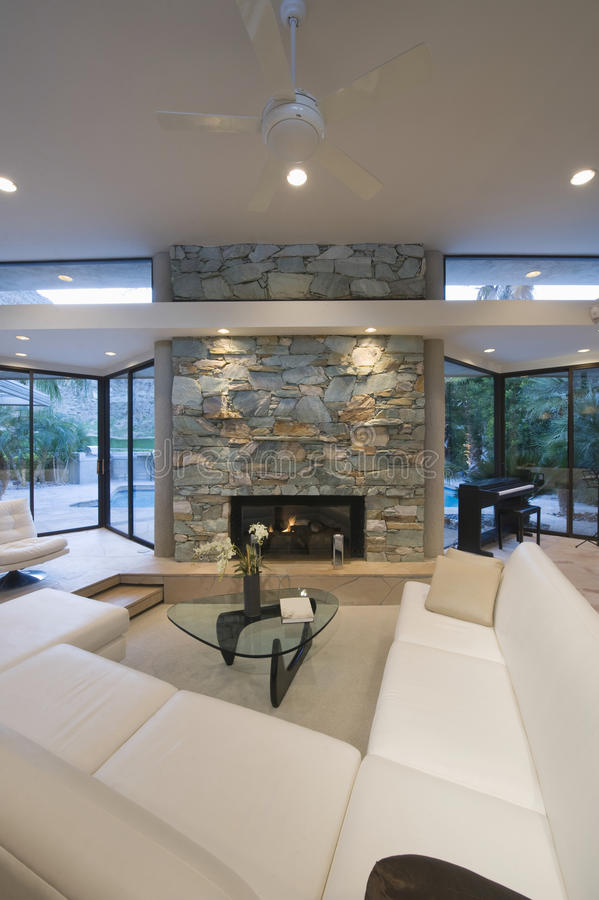 Seating Area And Stone Fireplace. Sunken seating area and stone fireplace at modern home royalty free stock image