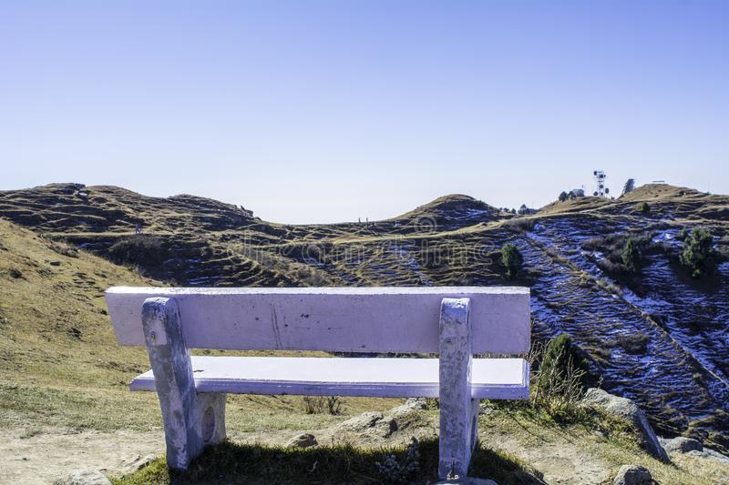 Seating Bench at mountain top of snow and greenary for tourist attraction stock photos
