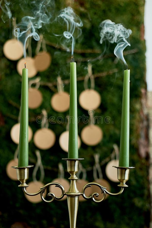 Seating plan, wedding decor in rustic style. Moss, bark, wood, crafting cards.Candle holder with extinguished candles. Seating plan, wedding decor in rustic stock photography